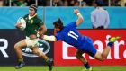 Cheslin Kolbe skates in to scores South Africa's third try in their demolition of Italy. Photograph: Adam Pretty/Getty