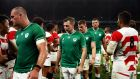 Ireland players leave the pitch following their defeat to Japan. Photograph: Cameron Spencer/Getty