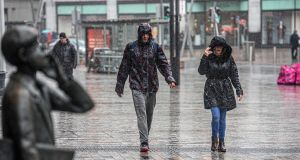 Pedestrians in Cork City as Storm Lorenzo hit on Thursday. More rain is expected over the weekend. Photograph: Michael Mac Sweeney/Provision