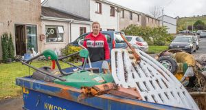 Sheena Culloo outside her Clarendon Drive home in Donegal town with some of the furniture and equipment destroyed by the flooding. Photograph: North West Newspix