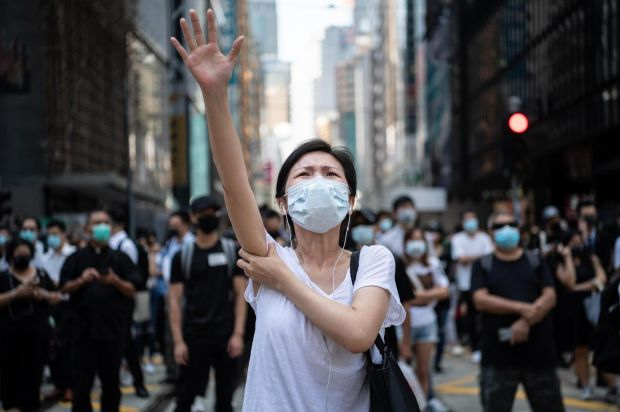 People protest a government ban on face masks in Hong Kong on Friday. Photograph: Laurel Chor/Getty