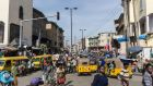 People walk through Balogun market in streets around Lagos Island. Lagos is the world's 10th largest city with between 17 and 22 million people, although no-one seems to be counting. Photograph: Stefan Heunis/AFP/Getty
