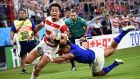 Japan's Kenki Fukuoka runs in to score a try during the 2019 Rugby World Cup Pool A match against Samoa. Photo: Anne-Christine Poujoulat/Getty Images