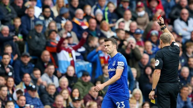 Seamus Coleman of Everton is shown the red card by referee Graham Scott at Turf Moor. Photograph: Alex Livesey/Getty Images