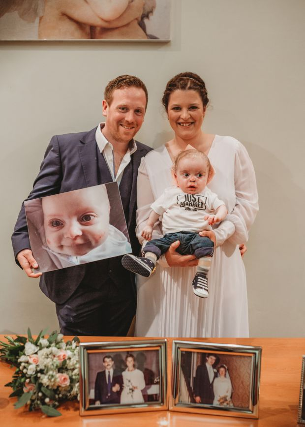 Maria and Barry's wedding day with Luca and a photograph of Lola.