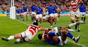 Japan's wing Kotaro Matsushima scores a try against Samoa during the  Pool A victory for the hosts   at the City of Toyota Stadium. Japan now have an eight-day rest before a huge game against Scotland.  Photograph: Adrian Dennis/AFP/Getty