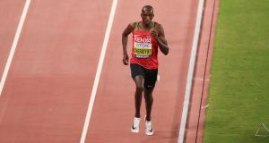 Timothy Cheruiyot of Kenya  in the  1,500m  final during day ten of the World Athletics Championships in Doha, Qatar. Photograph:  Christian Petersen/Getty Images