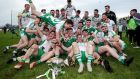 Killoe Emmet Og players celebrate with the trophy. Photograph: Laszlo Geczo