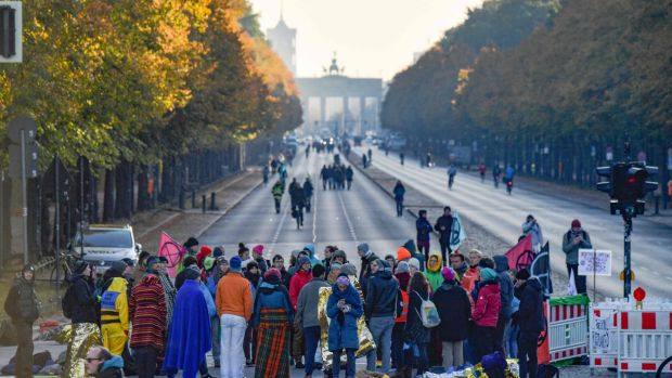 Protesters block one of the roads around the Victory Column (Siegessaeule) to mark the beginning of the Extinction Rebellion protests in Berlin, on October 7th, 2019. Photograph: Tobias Schwartz/AFP.