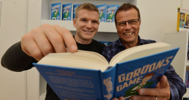 Gordon D'Arcy and Paul Howard with Gordon's Game, their  new children's book. Photograph: Alan Betson