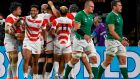 Japan players  celebrate scoring a try against Ireland. But they still have work to do to reach the quarter-finals for the first time. Photograph: William West/AFP/Getty