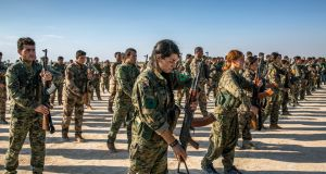 Kurdish fighters with the American-backed Syrian Democratic Forces in Hukumya, Syria, stand in formation during a funeral for comrades killed in fighting against the Islamic State in October 2017. Photograph: Ivor Prickett/The New York Times