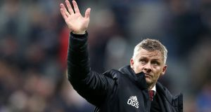 United manager Ole Gunnar Solskjaer waving  to  fans after his team's  defeat to Newcastle at St James' Park,  Newcastle upon Tyne. Photograph:   Jan Kruger/Getty Images