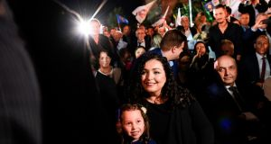 Vjosa Osmani, election candidate for prime minister from the opposition party Democratic League of Kosovo (LDK) with her daughter during an electoral rally in Pristina. Photograph:  Armend Nimani/AFP via Getty