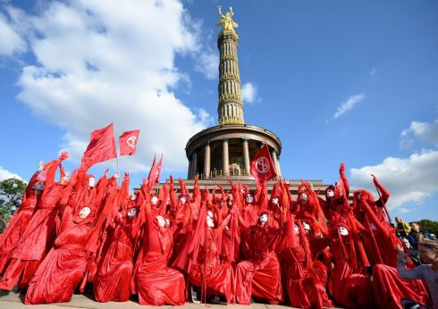 MAKING AN IMPACT: Extinction Rebellion climate-crisis protesters wear red costumes as they perform at a roadblock in Berlin. The activists have kicked off a fortnight of global civil disobedience. Photograph: Christophe Gateau/dpa/AFP/Getty