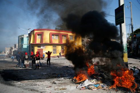 HAITI BURNS: Anti-government protesters near a burning barricade as Haiti enters a fourth week of protests, which have paralysed the economy, in the capital, Port-au-Prince. Opposition leaders are pushing for the resignation of President Jovenel Moise. Photograph: Rebecca Blackwell/AP Photo