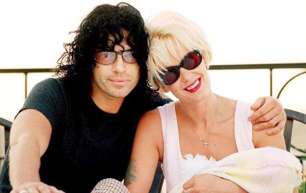 Michael Hutchence: the singer with Paula Yates and their baby, Heavenly Hiraani Tiger Lily, in 1996. Photograph: Jeff Darmanin/Reuters