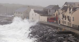 Waves crash agains the sea wall in Lahinch, Co Clare as thousands of homes and businesses were left without power as Storm Lorenzo passed across Ireland. Photograph: Brian Lawless/PA Wire