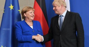 German chancellor Angela Merkel and British prime minister Boris Johnson: held a bruising phone conversation. File phototograph (August 2019): Stefan Rousseau/PA