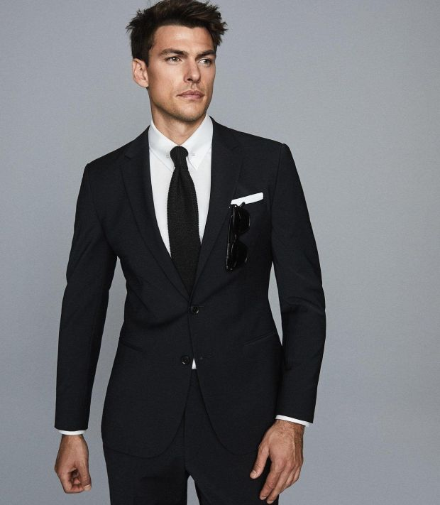 Black blazer, €360, trousers, €165, Reiss