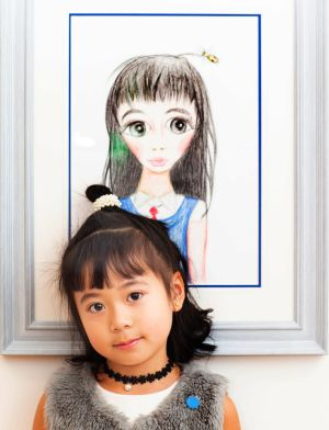 At the the National Gallery of Ireland's Zurich Young Portrait Prize event was Rita Ruitong Chen (6) with her painting, School Girl. Photograph: Tom Honan/The Irish Times.