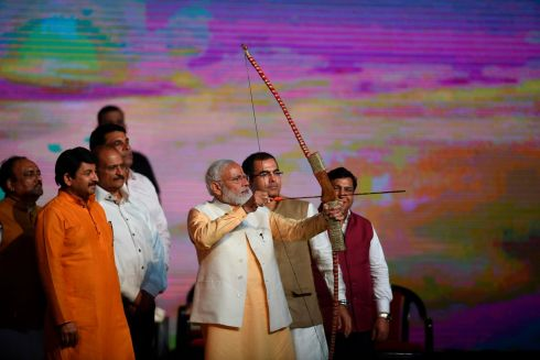 Indian prime minister Narendra Modi (centre) at an event before burning of an effigy of the Hindu demon Ravana. Photograph: Money Sharma/Getty