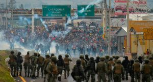 Demonstrators and riot police clash in Quito on Monday following days of protests against the sharp rise in fuel prices following the authorities' decision to scrap subsidies. Photograph: Rodrigo Bundia/AFP via Getty Images