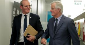 Minister for Foreign Affairs Simon Coveney and the EU's chief Brexit negotiator, Michel Barnier, ahead of talks at the European Commission. Photograph: Stephanie Lecocq/EPA