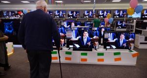 Minister for Finance Paschal Donohoe's budget speech is broadcast on multiple televisions at Harvey Norman Airside Retail Park. Photograph: Alan Betson