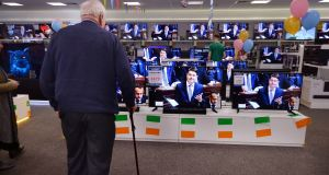 The Budget 2020 speech by Minister for Finance Paschal Donohoe on display across multiple televisions at Harvey Norman Airside Retail Park. Photograph: Alan Betson/The Irish Times