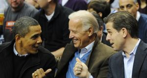 Then US president Barack Obama  greets vice president Joe Biden  and his son Hunter at a college basketball game in Washington in  January 2010. Photograph: Alexis C Glenn/EPA