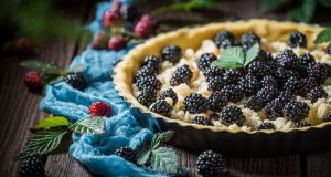 Homemade tart with blackberries and caster cugar
