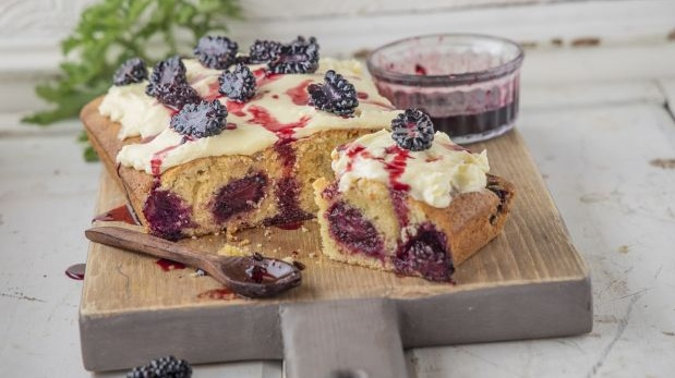 Blackberry cake with cream cheese icing and blackberry coulis