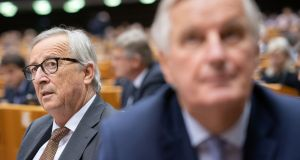 Jean-Claude Juncker, president of the European Commission, beside Michel Barnier, the EU's chief Brexit negotiator, at the European Parliament in Brussels on Wednesday. Photograph:  Jasper Juinen/Bloomberg