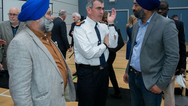 Garda Commissioner Drew Harris speaking to Gurbir Singh Chadha (left) and Ravinder Singh Oberoi from Lucan (right) during the launch the Garda Siochana Diversity and Integration Strategy 2019-2021 in Balbriggan, Dublin. Photograph: Gareth Chaney/Collins