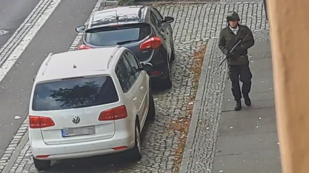 The suspected shooter walking along a street in Halle, Germany, in this screenshot from ATV-Studio Halle video. Photograph: Andreas Splett/ATV-Studio Halle/AFP via Getty Images