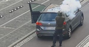 In this screenshot taken from a video by ATV-Studio Halle, a man fires a gun in the streets of Halle an der Saale, eastern Germany. Photograph: Andreas Splett/ATV-Studio Halle/AFP via Getty Images