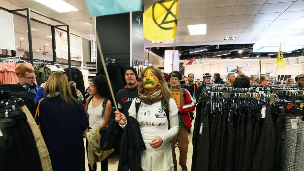 Extinction Rebellion protesters demonstrate in Penneys. Photography: Brian Lawless / PA Wire