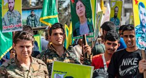 Fighters and veterans from the Kurdish women's protection units  and the people's protection units  marched on Tuesday in front of the UN headquarters in the northern Kurdish Syrian city of Qamishli during a protest against Turkish threats. Photograph: Delil Souleiman/AFP.