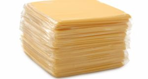 Processed Sliced Cheese on White.