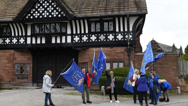 Anti-Brexit demonstrators protest outside Thornton Manor Hotel, near Birkenhead, north-west England. Photograph: Leon Neal / AFP