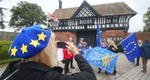 Anti-Brexit protesters outside the entrance to Thornton Manor, a luxury wedding venue on The Wirral, in Cheshire, where British prime minister Boris Johnson and Taoiseach Leo Varadkar are meeting in a bid to break the Brexit deadlock . Photograph: Danny Lawson/PA Wire