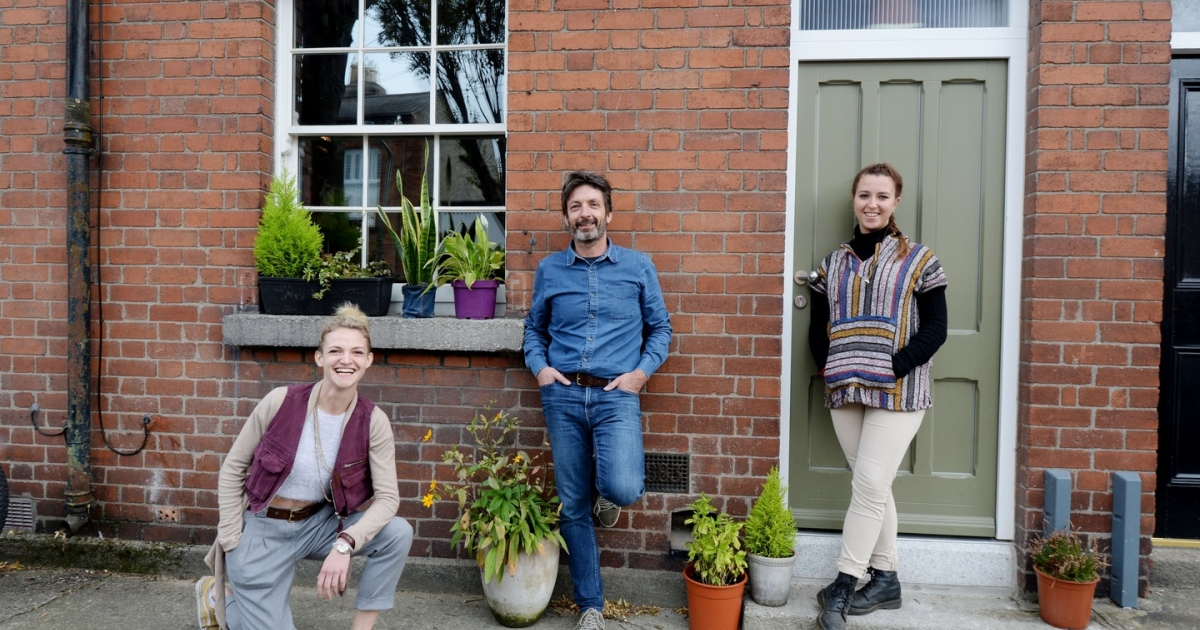 Jim Cogan with his sister Katie Cogan (left) and daughter Lara Cogan  in the house at Kingsland Parade, Dublin 8 which he renovated. Photograph: Alan Betson/The Irish Times