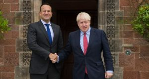 Taoiseach Leo Varadkar and British prime minister Boris Johnson shake hands  outside Thornton Manor Hotel near Birkenhead on Thursday. Photograph: Noel Mullen/Government Press Office via Getty Images