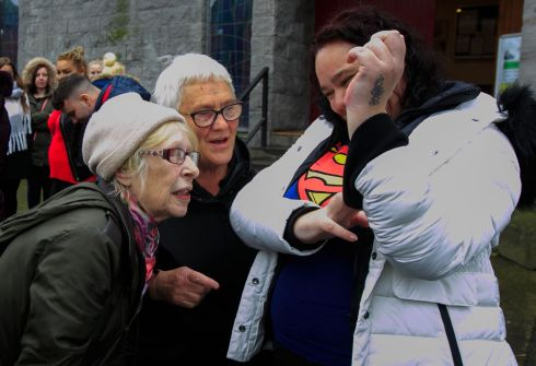 STEPHEN GATELY: Chrissie Arshad from Manchester shows her Superman tattoo in memory of Stephen Gately to his mother Margaret Gately during a 10-year anniversary Mass for the former Boyzone star at St Laurence O'Toole church on Sheriff Street, Dublin. Photograph: Gareth Chaney/Collins