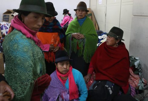 ECUADOR: Indigenous women, part of the many groups of people demonstrating against the government, gather at La Casa de la Cultura in Quito, Ecuador. Protests started last week after Ecuador's president Lenín Moreno ended fuel subsidies, leading to price increases. Photograph: Fernando Vergara/AP