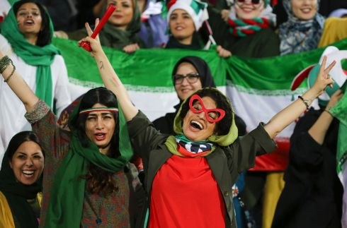 A CAUSE FOR CELEBRATION: Iran supporters cheer during their side's victory over Cambodia in a qualifier at the Azadi stadium in Tehran for the 2022 World Cup in Qatar. It was the first time women were allowed attend a football match in the country for about 40 years. Photograph: Atta Kenare/AFP via Getty Images