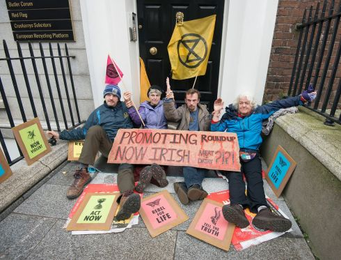 EXTINCTION REBELLION: Colm Burke, Carmel Duffy, Fabian MacGinty O'Neill and Maura O'Donoghue of Extinction Rebellion, who today glued themselves to each other, and the railings outside the offices of Red Flag, a Dublin PR firm which represents Bord Bia. Photograph: Dave Meehan