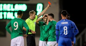 Ireland striker Troy Parrott  reacts after  receiving a red card from referee Sascha Stegemann in the Under-21 European Championship qualifier against Italy at  Tallaght stadium. Photograph: Oisín Keniry/Inpho