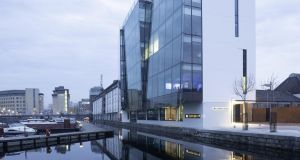 Waterways House's design  represents a fresh departure for Dublin, incorporating as it does, an area of office space which has been built out above the water